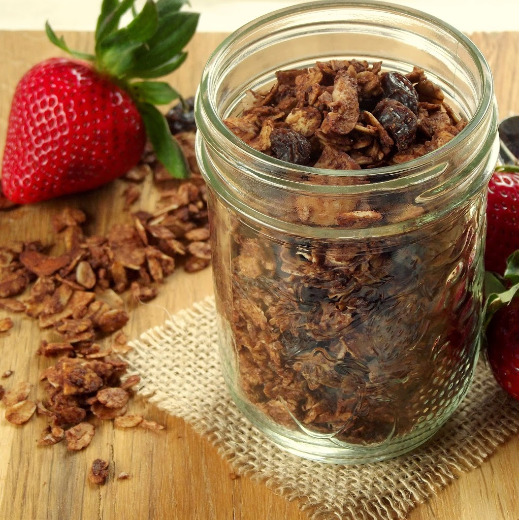 Jar of Chocolate Granola with Strawberries in the Background
