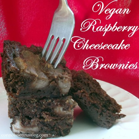 """Brownies on a Plate with Fork Against a Red Background with Text Reading """"Vegan Raspberry Cheesecake Brownies"""""""