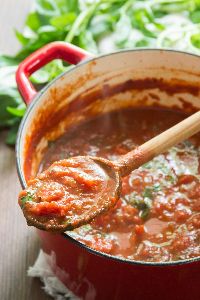 Wooden Spoon Filled with Homemade Marinara Sauce