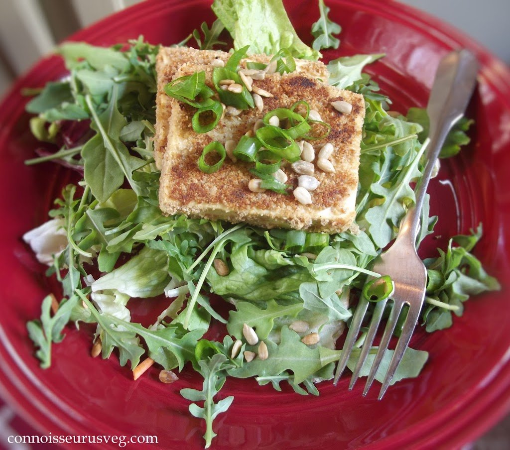 Tofu and Scallions Over Greens on a Plate with Fork