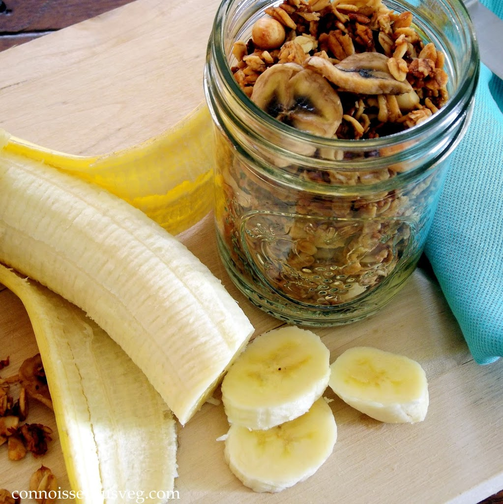 Sliced Banana and Jar of Granola on a Cutting Board