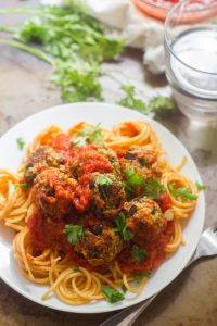 Eggplant Meatballs and Tomato Sauce Over Spaghetti on a Plate