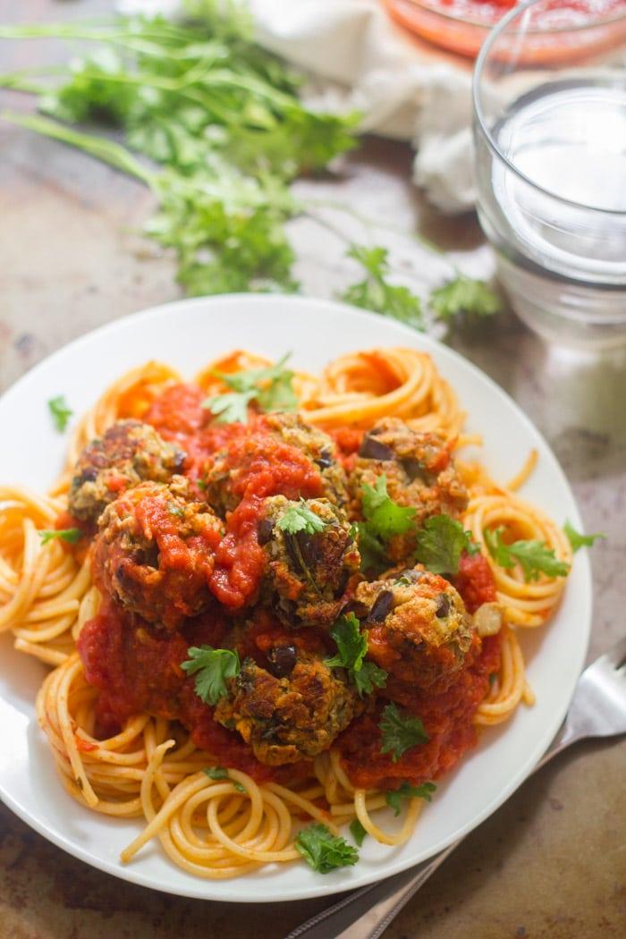 Eggplant Meatballs and Tomato Sauce Over Spaghetti on a Plate