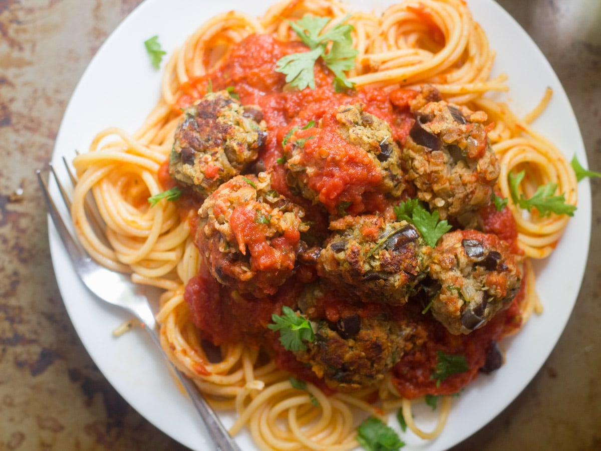Spaghetti Topped with Eggplant Meatballs on a Plate with Fork