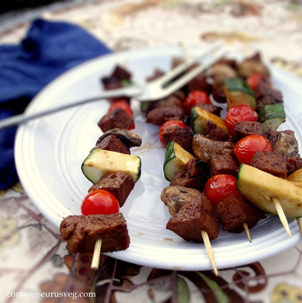 Close Up of Veggie Seitan Kebabs on a Plate with Grilling Fork