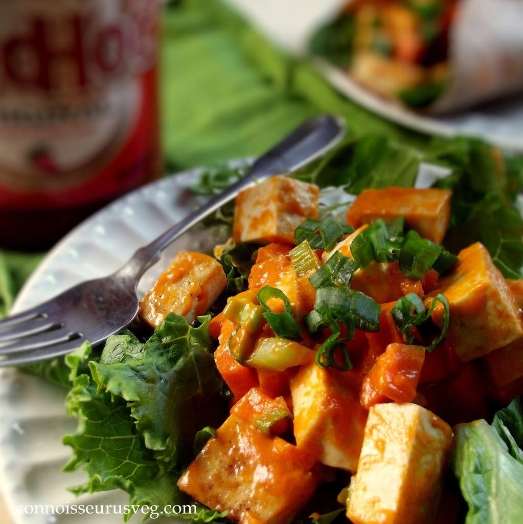 Dish of Buffalo Tofu Over Greens with Fork