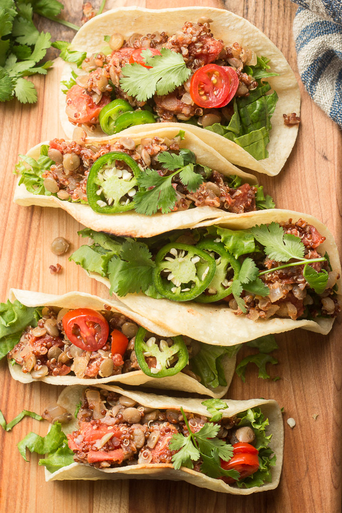 Five Lentil Quinoa Tacos on a Wooden Surface