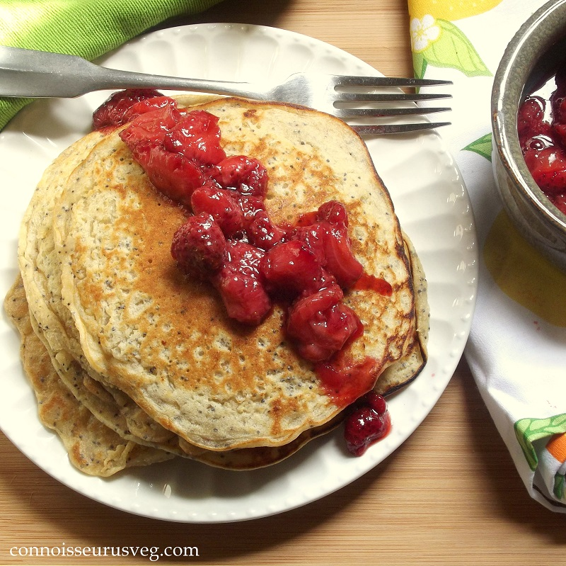 Overhead View of a Plate of Quinoa Pancakes with Roasted berries on Top