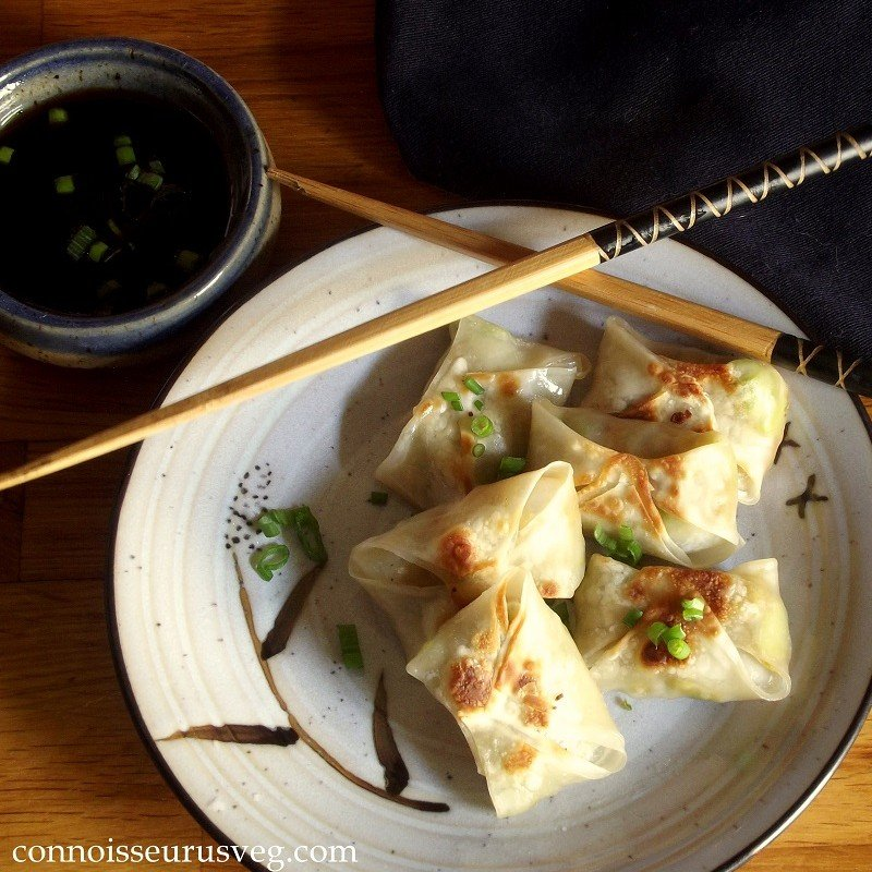 Overhead View of Wontons on a Plate with Chopsticks