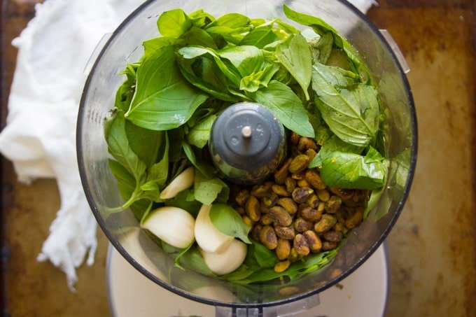 Food Processor Filled with Ingredients for Making Vegan Pesto