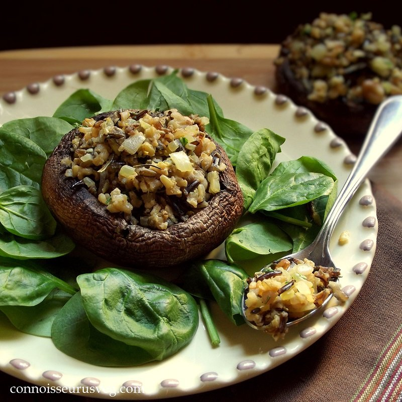 Stuffed Portobello Cap on a Plate with Greens and Spoon