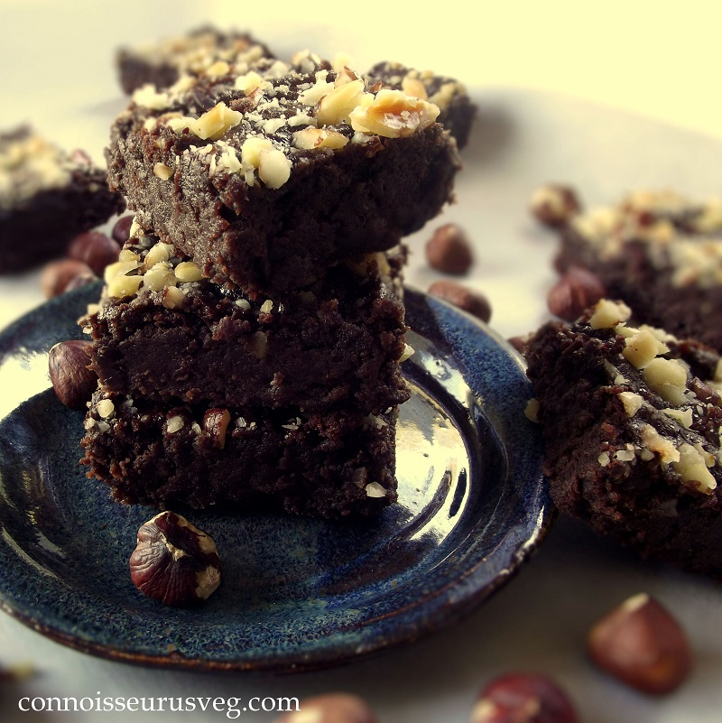Stack of Hazelnut Brownies on a Blue Plate
