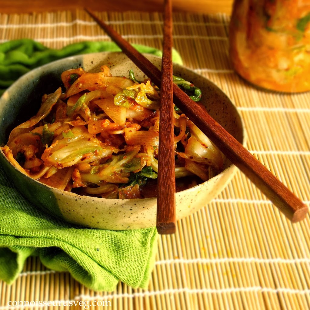 Bowl of Kimchi with Chopsticks, Jar of Kimchi in the Background