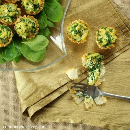 Overhead View of Mini Quiches with Greens and Fork