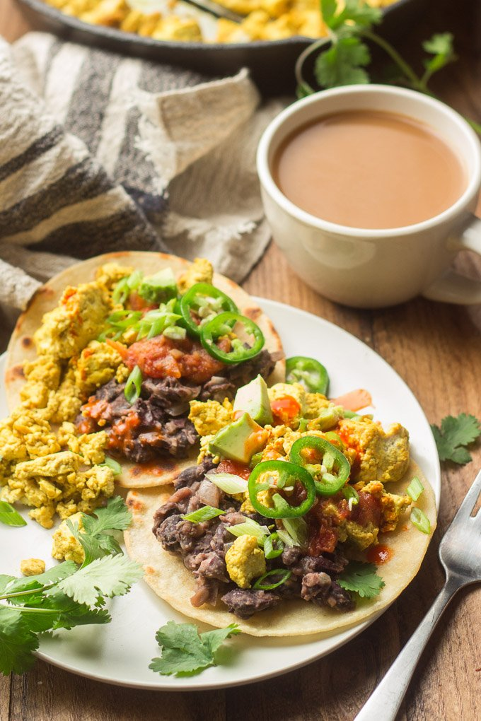Plate of Vegan Huevos Rancheros with Coffee Cup in the Background