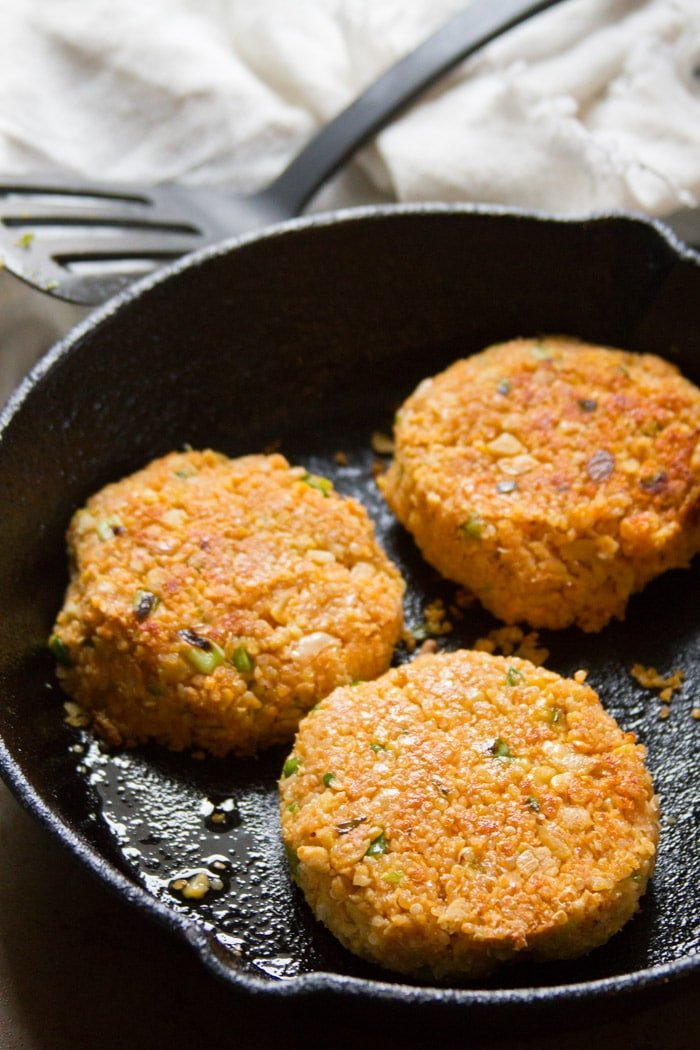 Buffalo Chickpea Quinoa Burger Patties in a Skillet