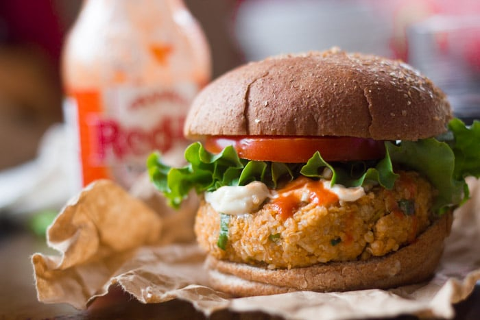 Close Up of a Buffalo Chickpea Quinoa Burger on Deli Paper