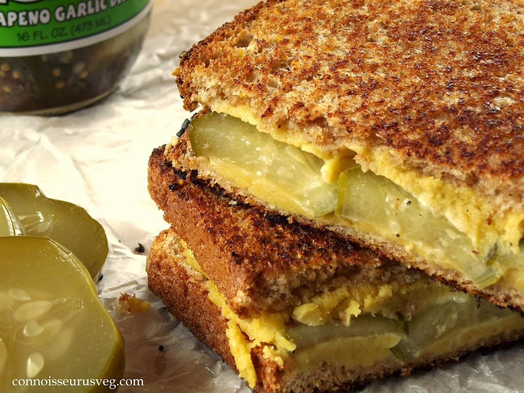 Close Up of Two Stacked Halves of a Pickle Grilled Cheese Sandwich