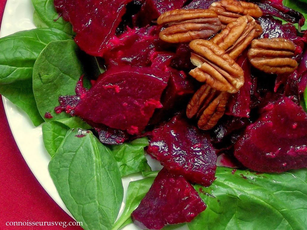 Close Up of Beet Salad with Pecans and Greens