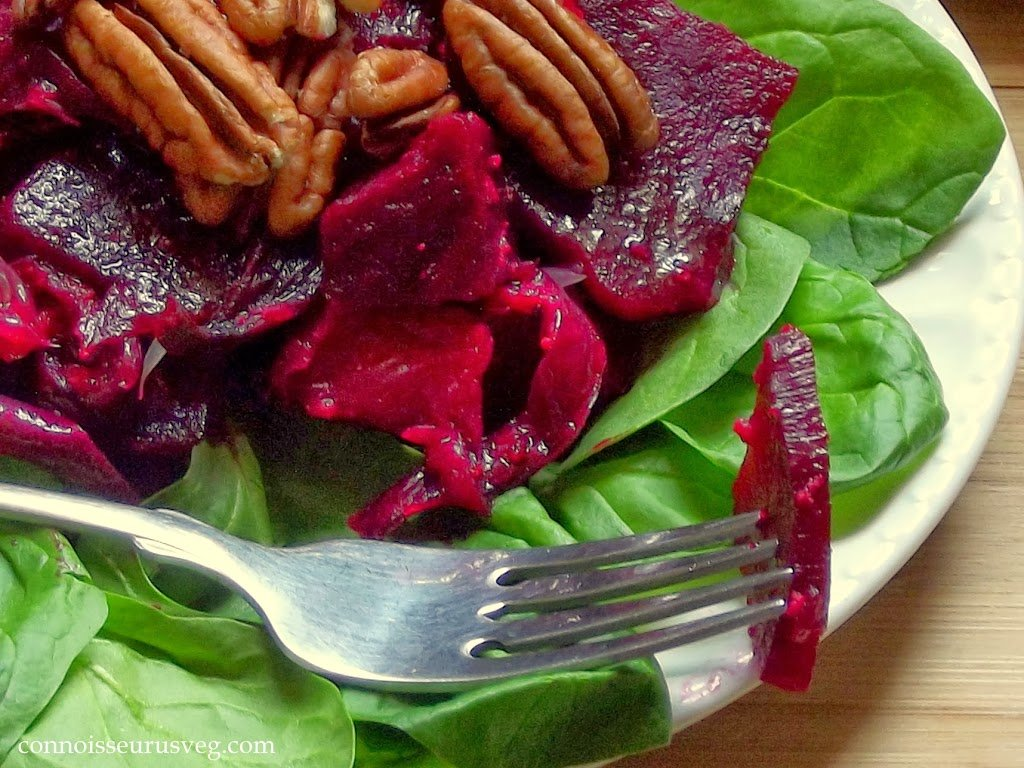Close Up of Beet Salad with a Bite on a Fork