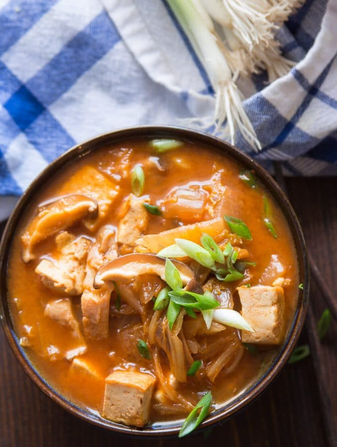 Bowl of Kimchi Stew Topped with Scallions