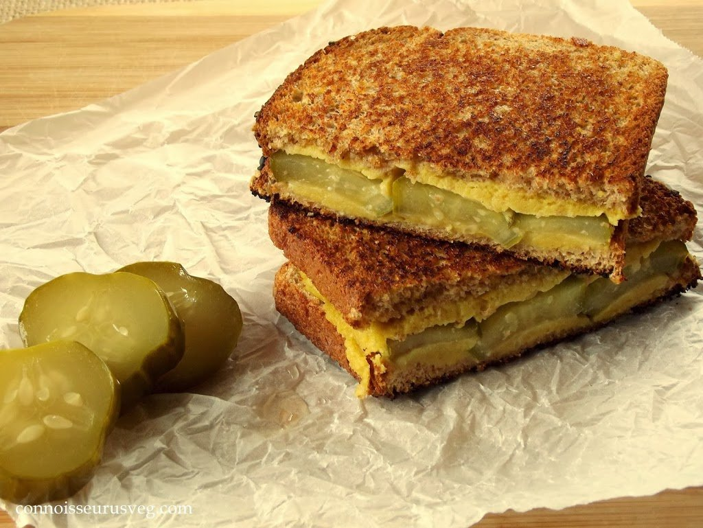Two Halves of a Pickle Grilled Cheese Sandwich Stacked on Top of Each Other