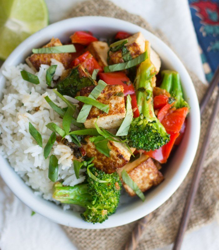 Overhead View of a Bowl of Thai Basil Tofu Stir Fry and Rice, with Chopsticks on the Side