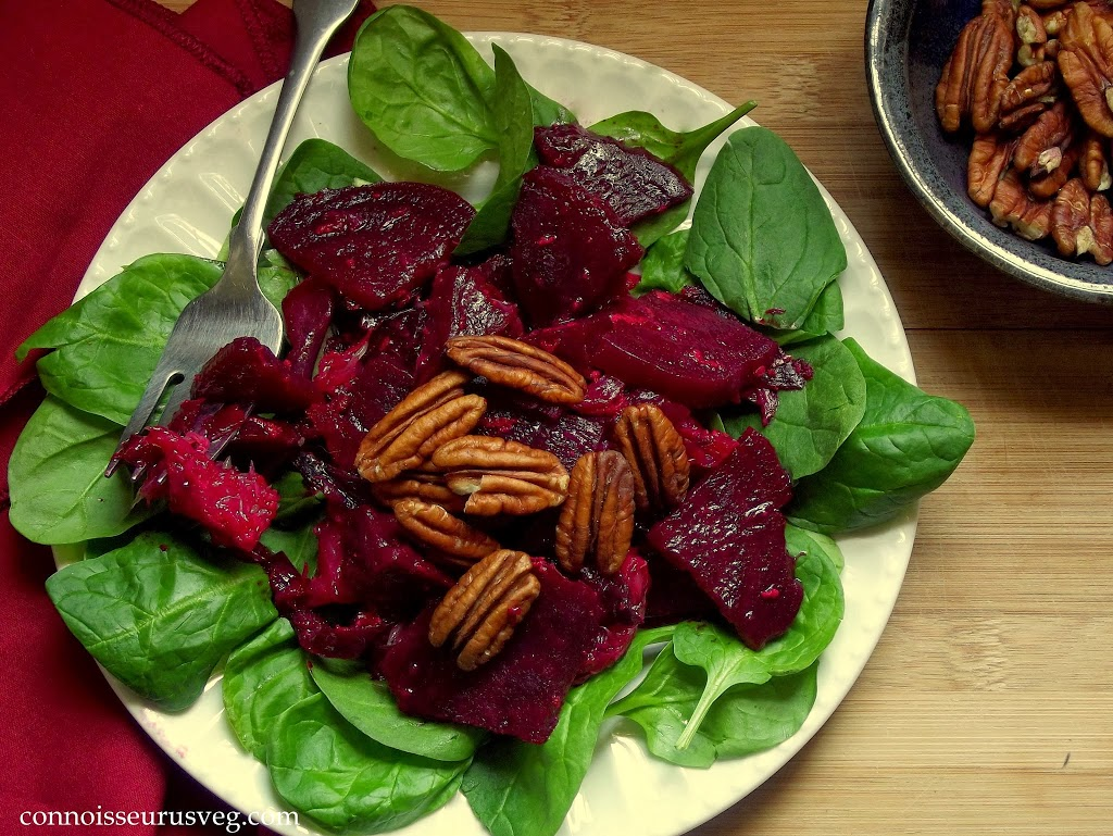 Overhead View of Beet Salad on a Plate with Greens and Pecans