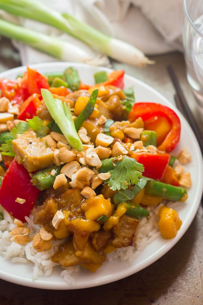 Close Up of Vegan Mango Chicken Stir-Fry on a Plate with Chopsticks