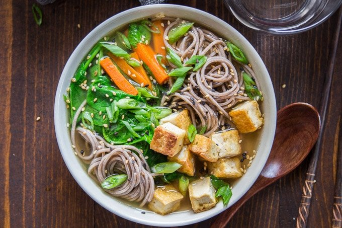 Overhead View of a Bowl of Miso Soba Noodle Soup with Crispy Tofu