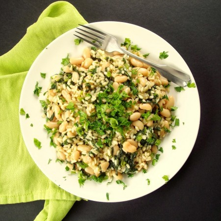 Overhead View of a Plate of Risotto on a Black Surface with Green Napkin