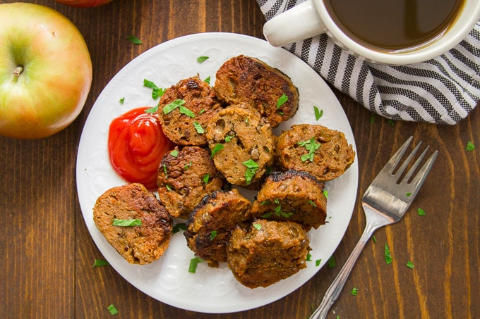 Overhead View of Vegan Breakfast Sausage on a Place with Fork and a Cup of Coffee