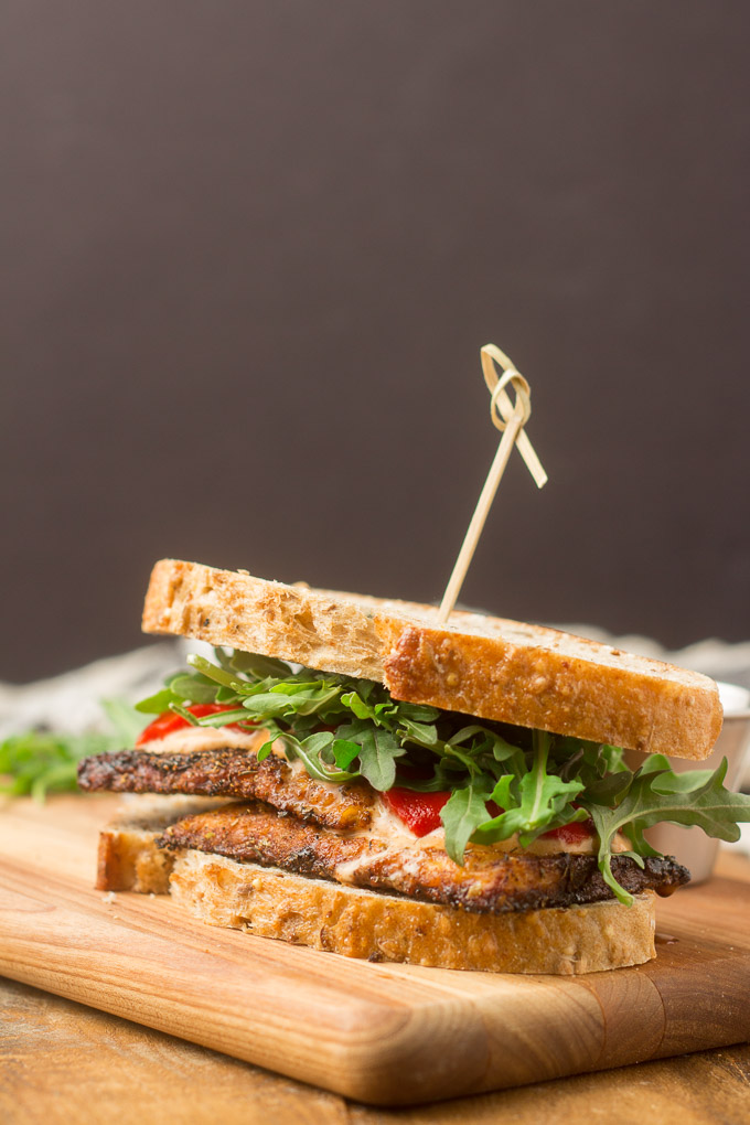 Blackened Tempeh Sandwich Against a Black Background