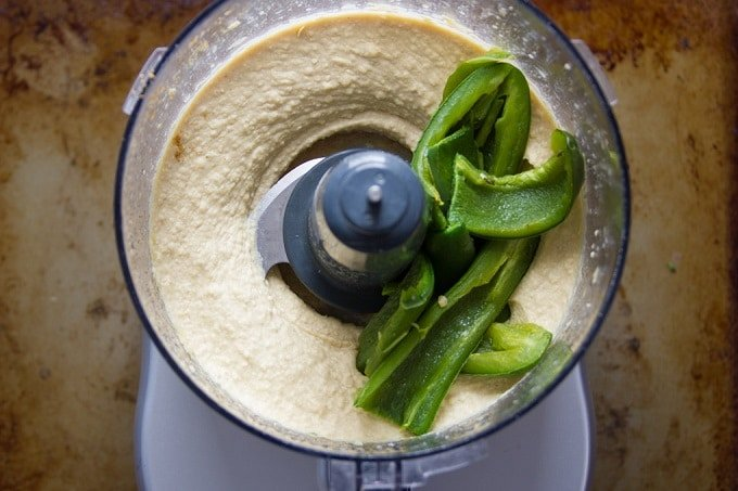 Hummus in a Food Processor Bowl with Roasted Jalapeno Pieces