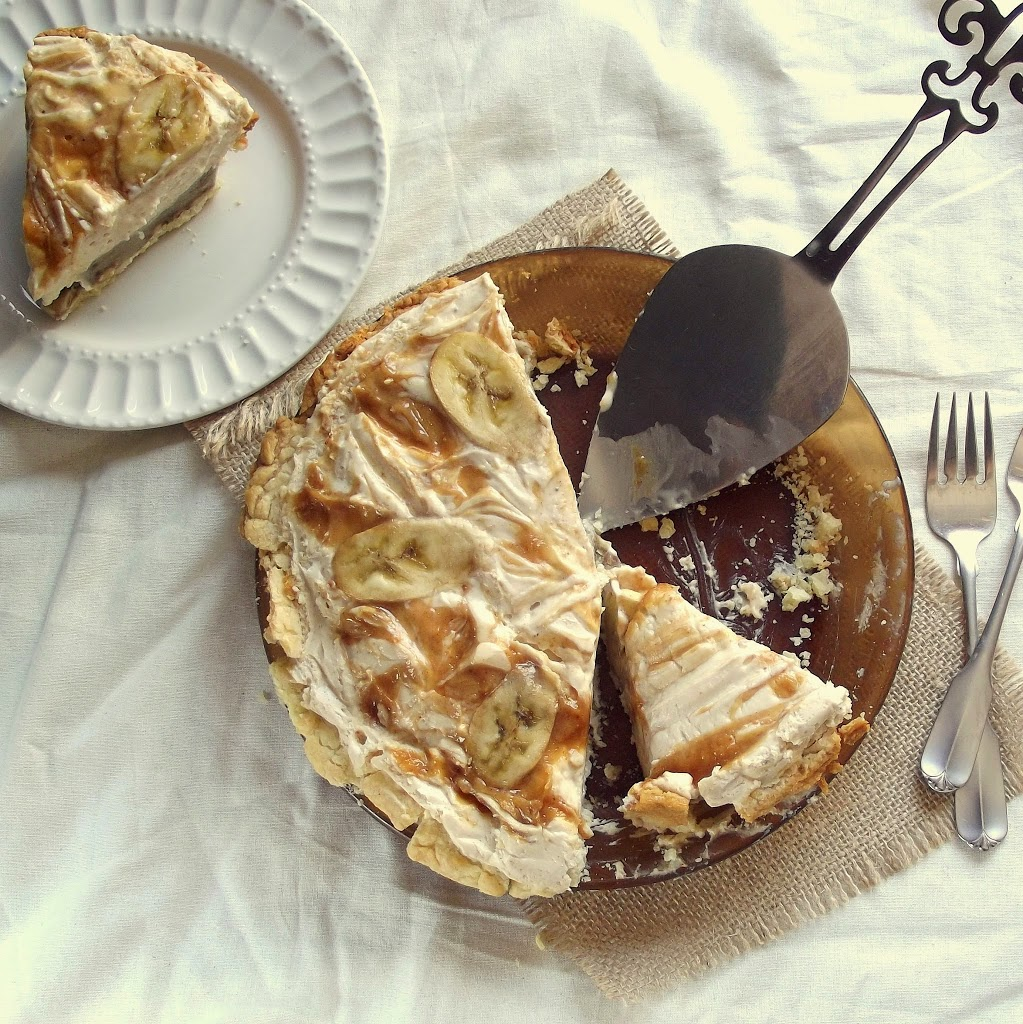 Overhead View of Table Set with Vegan Banana Pie, Server, Silverware, and Slice of Pie on a Plate