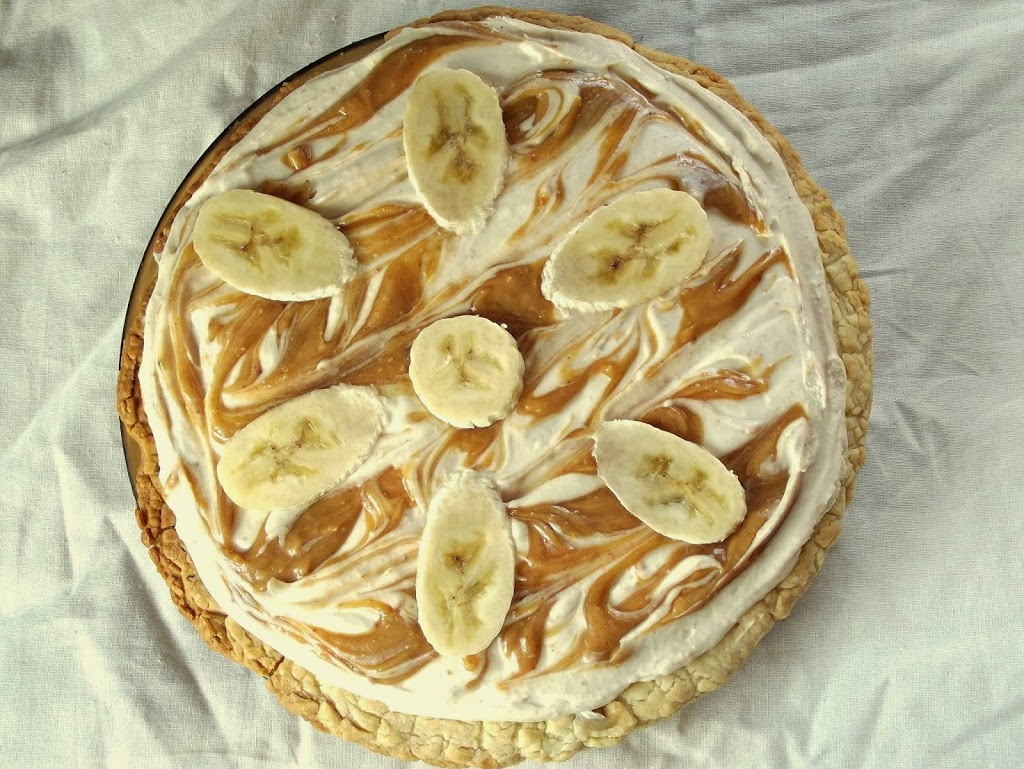 Overhead View of a Whole Vegan Banana Pie Garnished with Banana Slices