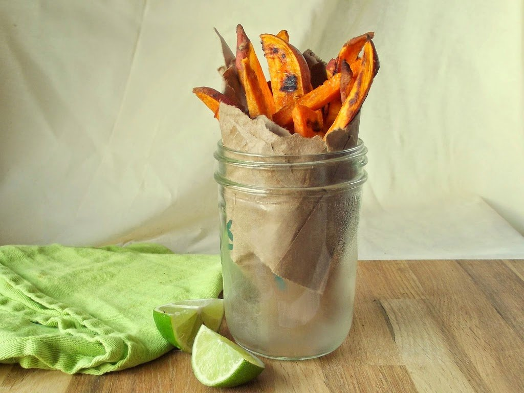 Jar of Sweet Potato Fries with Green Napkin and Lime Wedge on the Side