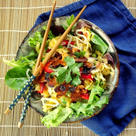 Overhead View of a Bowl of Mango Salad with Chopsticks on Top