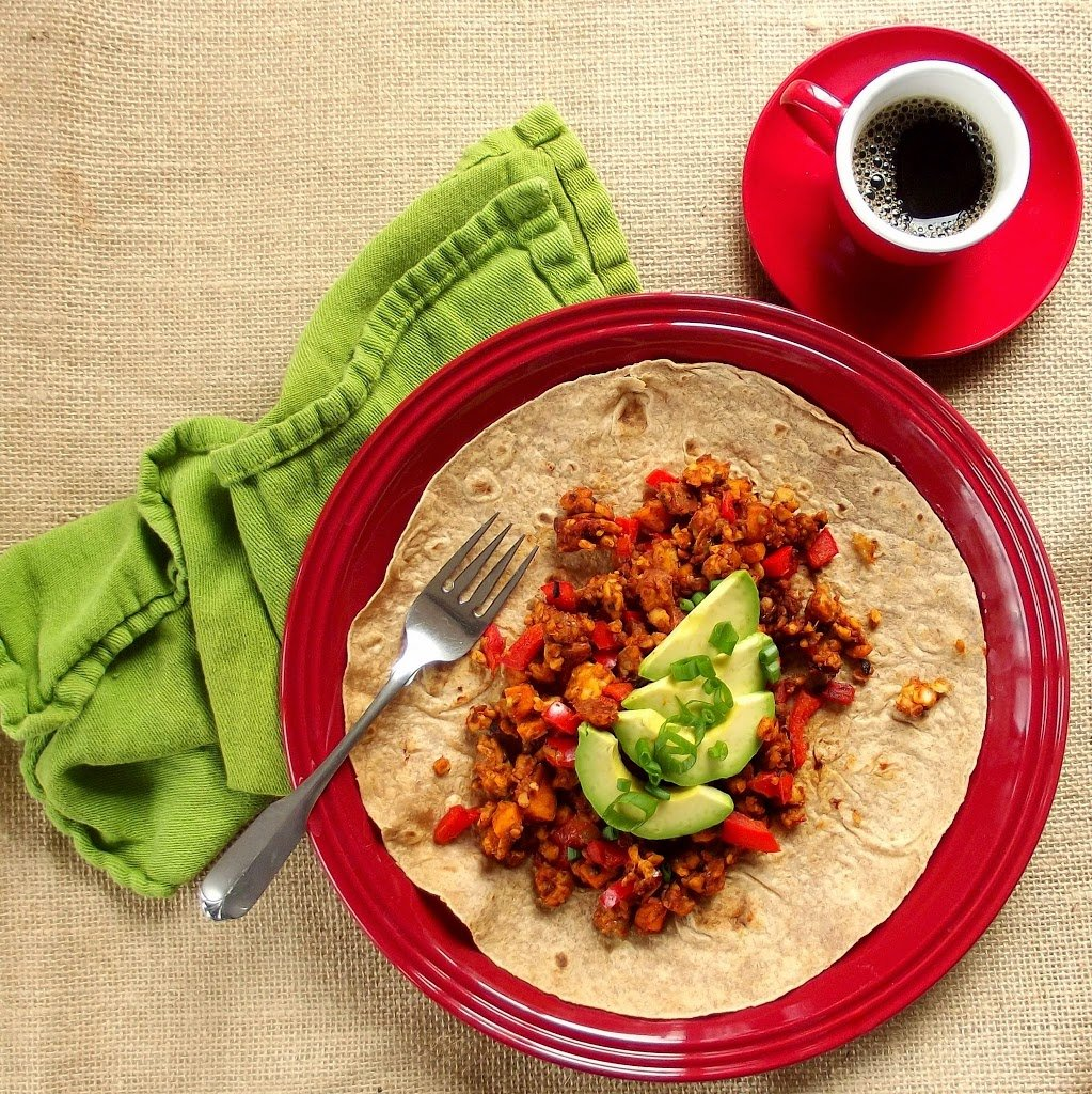 Overhead View of a Table Set with Coffee Cup, Green Napkin and Plate of Tempeh Scramble on a Tortilla
