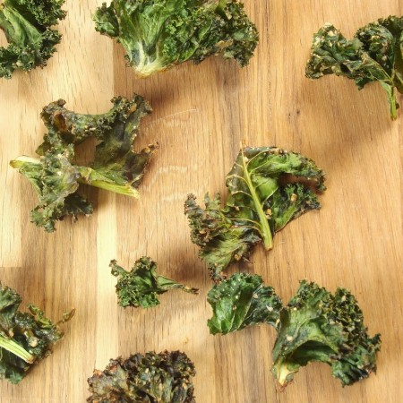 Kale Chips on a Wooden Surface