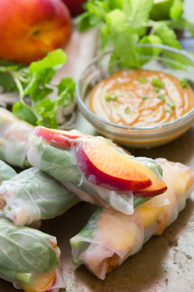 These sweet and savory peach summer rolls are stuffed with fresh, juicy summer peaches, fresh herbs and spiced tofu. They're pure heaven when dipped in creamy peanut sauce! #vegan #veganfood #veganrecipes #vegetarianrecipes #meatlessmonday #tofu #peaches