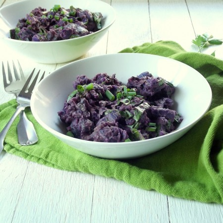 Two Bowls of Purple Potato Salad with Forks on the Side