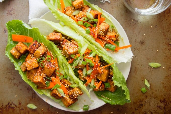 Overhead View of Three Ginger Sesame Tempeh Vegan Lettuce Wraps on a Plate