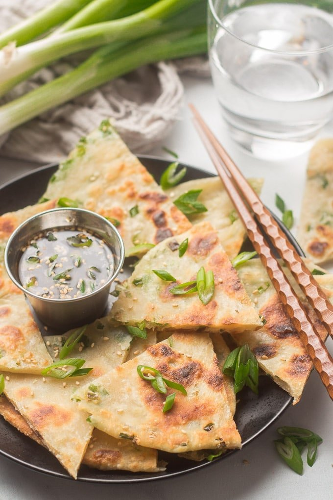 Scallion Pancake Slices with Dipping Sauce and Chopsticks on a Plate