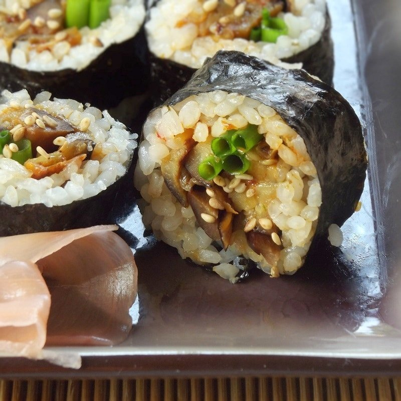 Close Up of Eggplant Sushi Slices on a Plate with Pickled Ginger