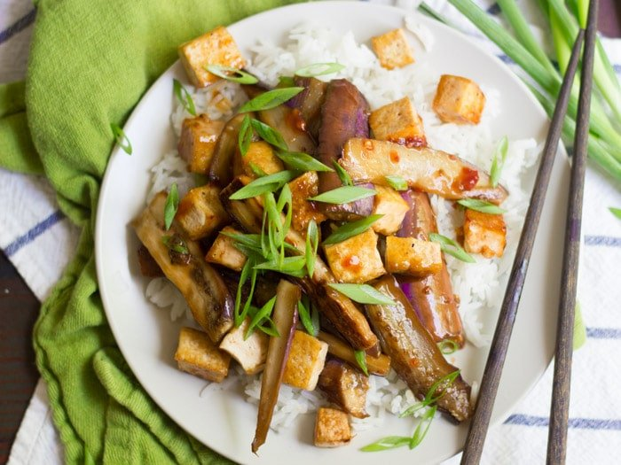 Overhead View of a Plate of Szechuan Tofu and Eggplant with Rice, Topped with Scallions