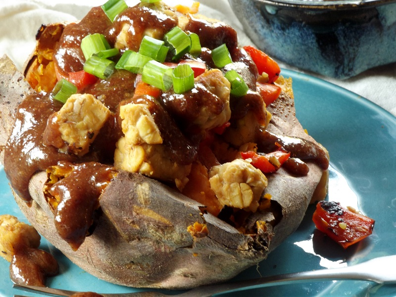 Ginger Tempeh Stuffed Sweet Potatoes with Almond Butter Sauce