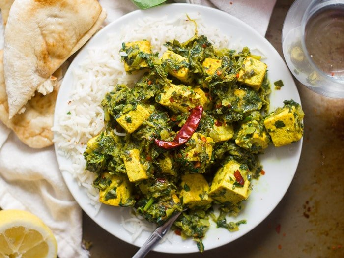 Overhead View of a Plate of Vegan Saag Paneer with Fork