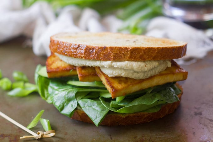 Close Up of a Smoky Baked Tofu Sandwich with Wasabi Cashew Mayo