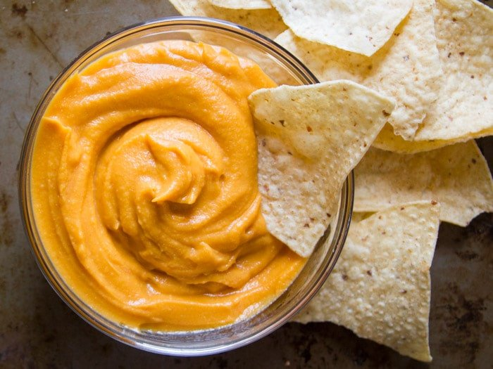 Bowl of Nacho Sweet Potato Cheese Surrounded by Tortilla Chips
